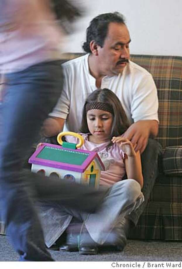 sos_montano108_ward.jpg  Leoncio Montano, left, seems lost in while his daughter Marilyn sits and other daughter Amairani runs across his living room. He recently lost his wife.  Leoncio Montano, a naturalized U.S. citizen from Mexico, lost his wife recently and now has to raise all his children on a blue collar salary. Montano's wife died in the desert trying to make her way home after visiting family.  11/20/05 Photo: Brant Ward