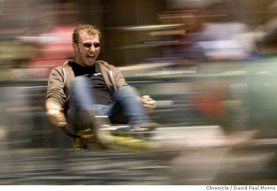 SAN MATEO, CA - MAY 19: Jordan Alperin of San Francisco uses pedal power to propel himself on a ride at the Maker Faire at the San Mateo Fairgrounds on Saturday May 19, 2007 in San Mateo, California. (Photograph David Paul Morris/The Chronicle) Photo: DAVID PAUL MORRIS