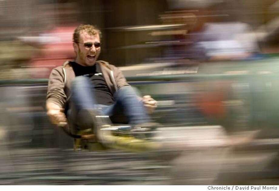 SAN MATEO, CA - MAY 19: Jordan Alperin of San Francisco uses pedal power to propel himself on a ride at the Maker Faire at the San Mateo Fairgrounds on Saturday May 19, 2007 in San Mateo, California. (Photograph David Paul Morris/The Chronicle) Photo: DAVID PAUL MORRIS
