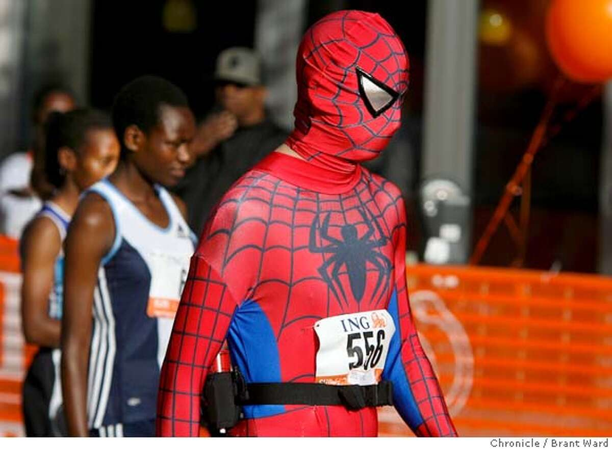 Yes that was Spiderman walking with some of the elite Kenyan runners minutes before the race started. The 96th annual Bay to Breakers foot race took over the streets of San Francisco Sunday morning as thousands ran from Howard and Beale Streets to Ocean Beach. {Brant Ward/San Francisco Chronicle}5/20/07
