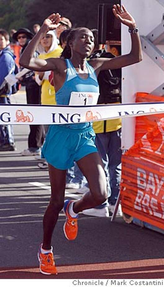 Women's winner Edna Kiplagat wins the Bay to Breakers at the Ocean Beach finish line. PHOTO: Mark Costantini / The Chronicle Photo: MARK COSTANTINI