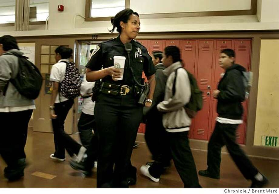 badge_angela148.JPG  In between classes at Everett Middle School, officer Rodriguez likes to stand in the hallways and watch the behavior of students as they pass from class to class.  SFPD officer Angela Rodriguez has a unique beat: a San Francisco middle school. She supervises about 600 students who attend Everett Middle School on Church Street not far from the station. At times she brings her pug Pumpkin to work with her. She finds the small dog helps her better relate and communicate with the young students.  {Brant Ward/San Francisco Chronicle}5/9/07 Photo: Brant Ward