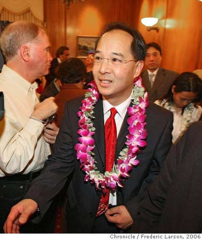 SF's newest supervisor Ed Jew surrounded by his supporters during a brief swearing in ceremony by the SF mayor Gevin Newsom at City Hall. Ed plans to bring his populist style of activism to City Hall for the benefit of the city's District 4 residents. 12/6/06  {Photographed by Frederic Larson} Ran on: 12-07-2006  Ed Jew is surrounded by his supporters during a brief swearing-in ceremony Tuesday at City Hall. Photo: Frederic Larson
