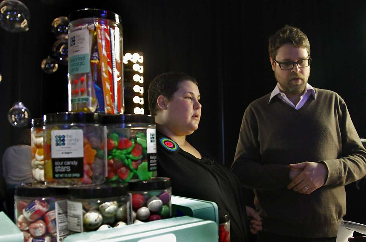 Diane Campbell, left, and her husband Brian Campbell display a selection of candies from their San Francisco candy boutique The Candy Store, which Target introduced as a partner in its new design program The Shops At Target, Thursday, Jan. 12, 2012. (AP Photo/Bebeto Matthews)