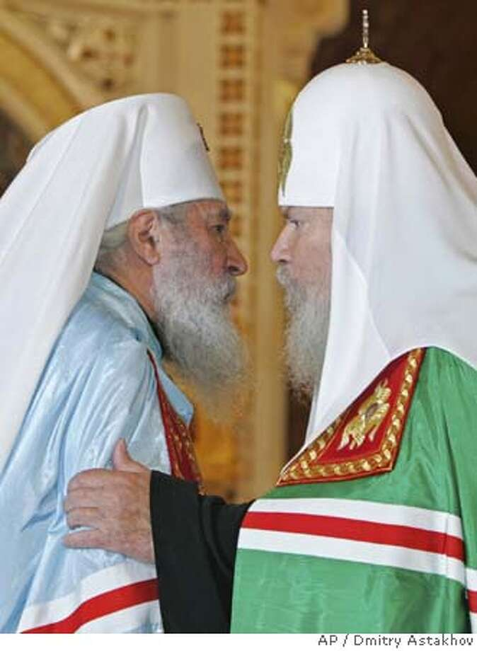 Moscow Patriarch Alexy II, right, leader of the main Russian Orthodox Church, and Metropolitan Laurus, head of the Russian Orthodox Church Outside of Russia, seen during a ceremony marking the reunion at Christ the Savior Cathedral in Moscow, Thursday, May 17, 2007. Leaders of the Russian Orthodox faith signed a historic pact healing a schism between the church in Russia, which for decades cooperated with Soviet authorities, and an offshoot set up abroad after the 1917 Bolshevik Revolution. (AP Photo/RIA-Novosti, Presidential Press Service, Dmitry Astakhov) Photo: DMITRY ASTAKHOV