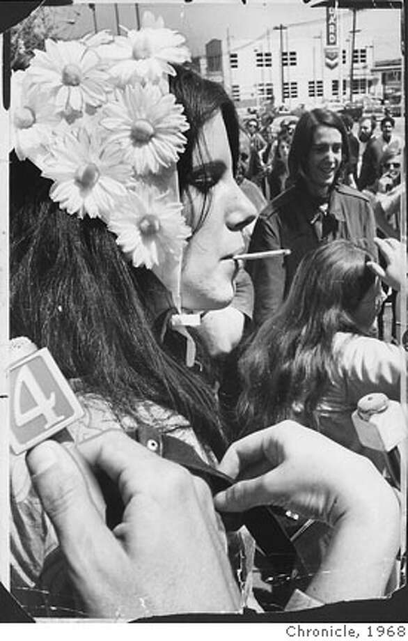 "A flower girl named Paula who was wearing a hat of daisies opened a cigarette case. ""Anybody want a joint?"" she asked. The response was slow, so she tossed a dozen cigarettes into the crowd.  Kathy Brady , 18, and Ralph Braun agreed that Bergess is a ""wonderful person."" Beat Hippies S.F. April 15, 1968 Photo: Archive"