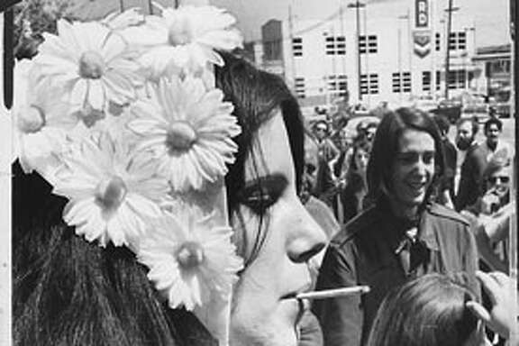 """A flower girl named Paula who was wearing a hat of daisies opened a cigarette case. """"Anybody want a joint?"""" she asked. The response was slow, so she tossed a dozen cigarettes into the crowd.  Kathy Brady , 18, and Ralph Braun agreed that Bergess is a """"wonderful person."""" Beat Hippies S.F. April 15, 1968"""