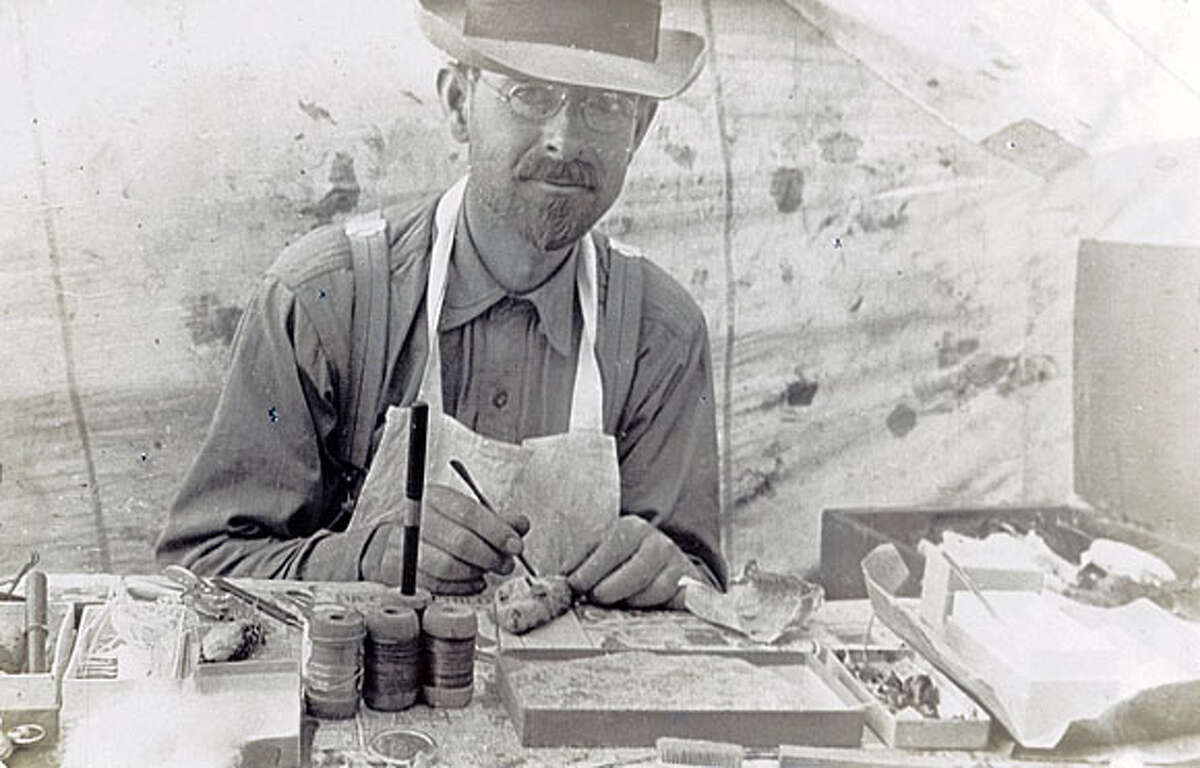 Joseph Grinnell skins a speciman in a field tent, circa 1922. THE BANCROFT LIBRARY, UNIVERSITY OF CALIFORNIA, BERKELEY