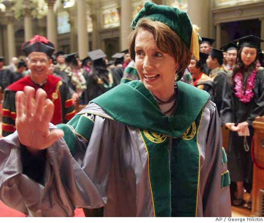 House Speaker Nancy Pelosi waves before the start of commencement exercises at the University of San Francisco, Saturday, May 19, 2007, in San Francisco. Pelosi delivered the commencement address at the exercises. University President Stephen Privett is at back, left. (AP Photo/George Nikitin) Photo: George Nikitin
