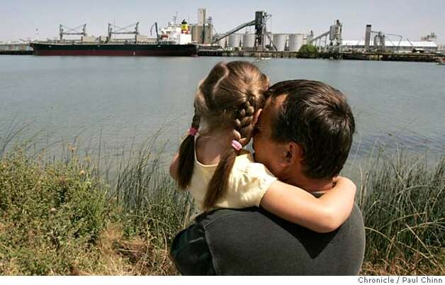 Alex Zavgorodnev brought his five-year-old daughter Victoria to the port to whale watch. Two wayward humpback whales continue to swim at the Port of Sacramento in West Sacramento, Calif. on Thursday, May 17, 2007. Marine biologists are hoping to lure the giants back towards the Pacific Ocean with whale sounds.  PAUL CHINN/The Chronicle  **Alex Zavgorodnev, Victoria Photo: PAUL CHINN