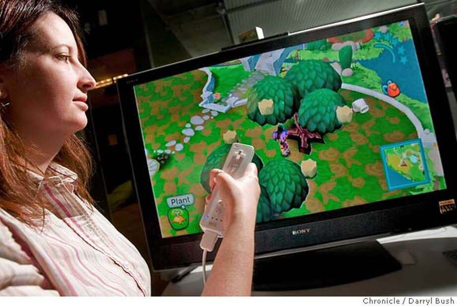 wii18_0001_db.JPG  Producer Shannon Copur of The Sims Division of Electronic Arts uses a wii control (in right hand raised) and a nunchuck (left hand) to play MySims in development for wii in their studios in Redwood city, CA, on Thursday, May, 17, 2007. photo taken: 5/17/07  Darryl Bush / The Chronicle ** Shannon Copur (cq) MANDATORY CREDIT FOR PHOTOG AND SF CHRONICLE/NO SALES-MAGS OUT Photo: Darryl Bush