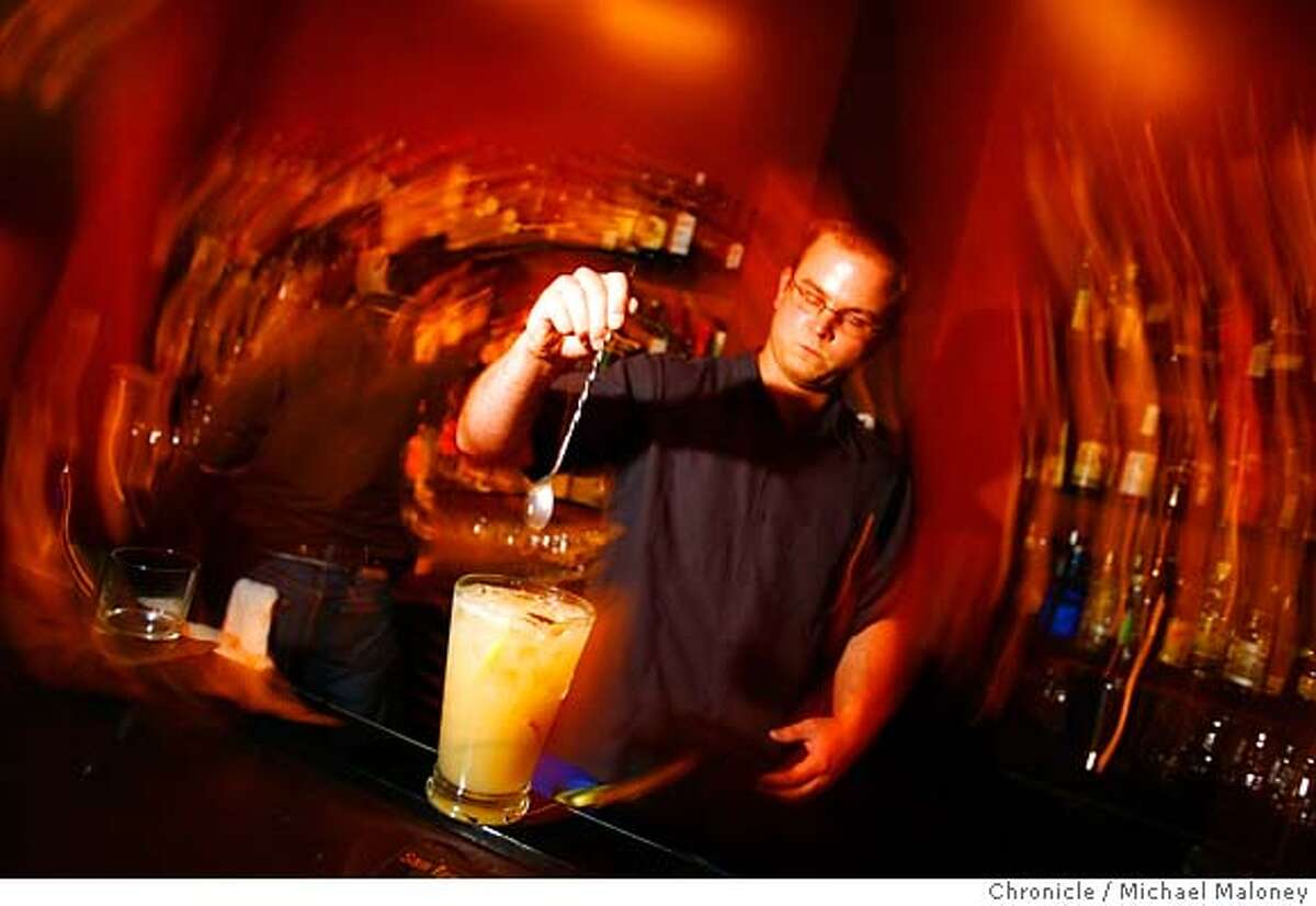 Aaron Prentice, owner of Cantina (580 Sutter) prepares a pitcher of pisco punch. Several of San Francisco�s top mixologists have organized a week-long celebration (called the San Francisco Cocktail Week)of San Francisco�s vibrant cocktail scene that culminates on Monday, May 21st at Absinthe Brasserie & Bar. On Monday, May 14, 2007, participants (mostly journalists and bar owners and workers) boarded a bus that transported them to a half dozen participating bars where they could sample two unique cocktails at each bar. Photo taken on 5/14/07 in San Francisco, CA. Photo by Michael Maloney / San Francisco Chronicle *** Aaron Prentice MANDATORY CREDIT FOR PHOTOG AND SF CHRONICLE/NO SALES-MAGS OUT