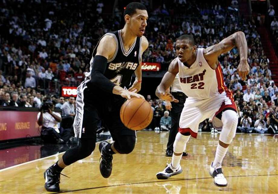 San Antonio Spurs' Danny Green (4) drives to the basket as Miami Heat's James Jones (22) defends during the second half of an NBA basketball game, Tuesday, Jan. 17, 2012, in Miami. The Heat won 120-98. (AP Photo/Lynne Sladky) Photo: Associated Press