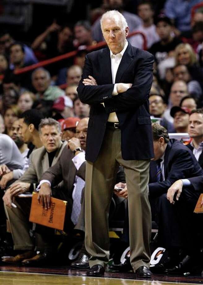 San Antonio Spurs head coach Gregg Popovich watches his team during the second half of an NBA basketball game against the Miami Heat, Tuesday, Jan. 17, 2012, in Miami. The Heat won 120-98. (AP Photo/Lynne Sladky) Photo: Associated Press