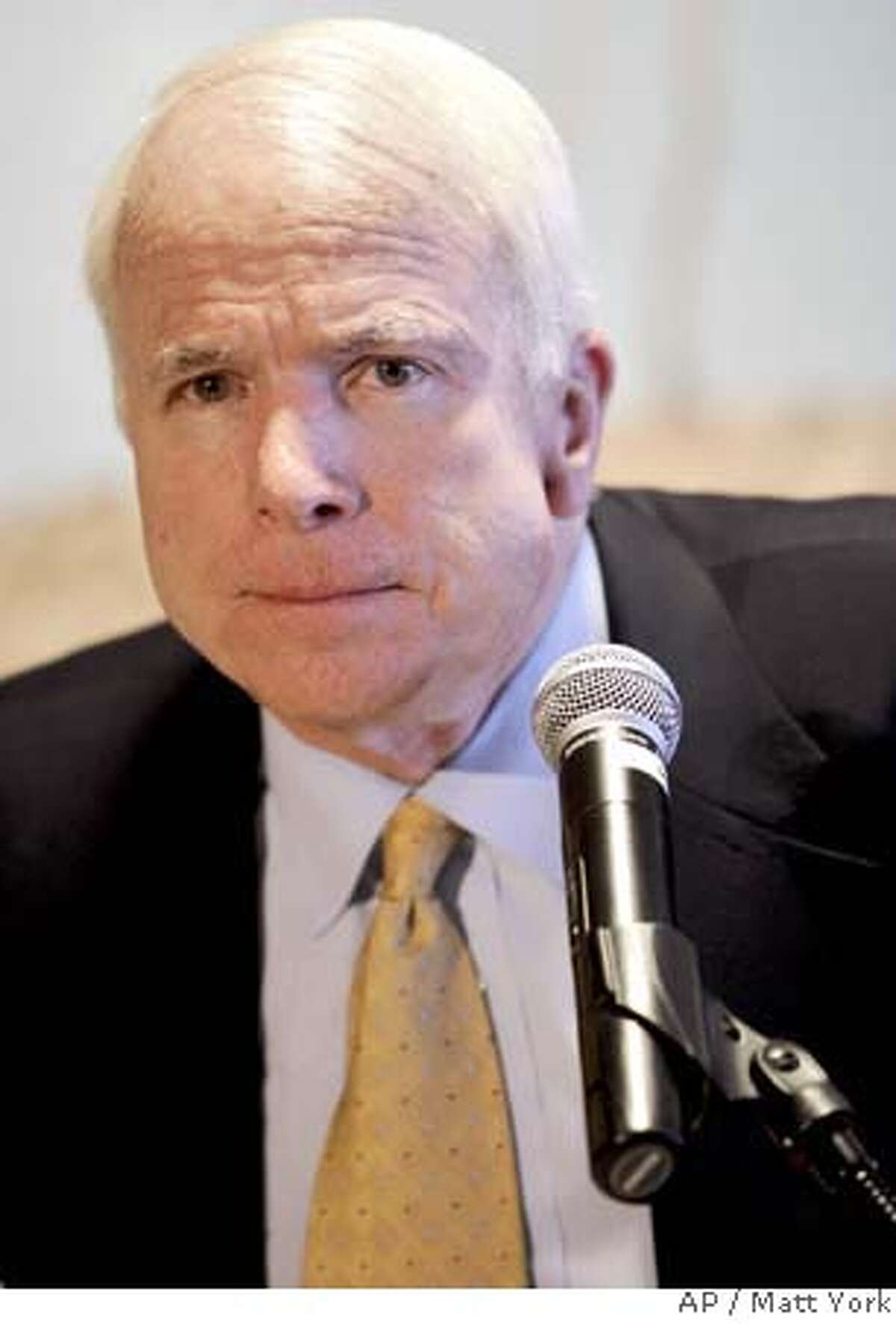 Republican presidential candidate Sen. John McCain, R-Ariz., takes a question at an immigration news conference Friday, May 18, 2007, at Sky Harbor International Airport in Phoenix. (AP Photo/Matt York)