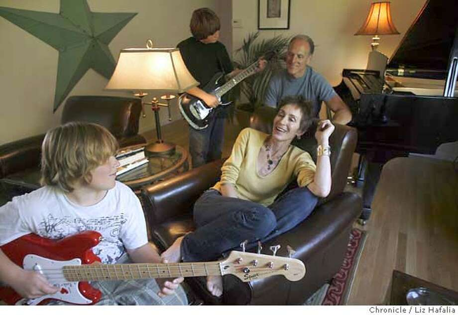 KEATS_022_LH_.JPG Kathryn Keats (middle, yellow shirt) with her family at home. Two sons Lorenzo Conti (front), 10 years old, and Andrew Conti (left, back), 12 years old, and husband Richard Conti. Kathryn Keats, a promising singer, was sexually and emotionally abused for years. When her case went to trial in 1983, Keats won and her abuser sent to a mental hospital. When he got out, he threatened Keats more. Keats went underground and married having two sons.  About a year ago, she learned her abuser had died and is now reclaiming her life, releasing her first CD. She is doing a domestic violence benefit in SF on May 23. Liz Hafalia/The Chronicle/San Francisco/5/16/07  **Kathryn Keats, Lorenzo Conti, Andrew Conti, Richard Conti cq Photo: Liz Hafalia