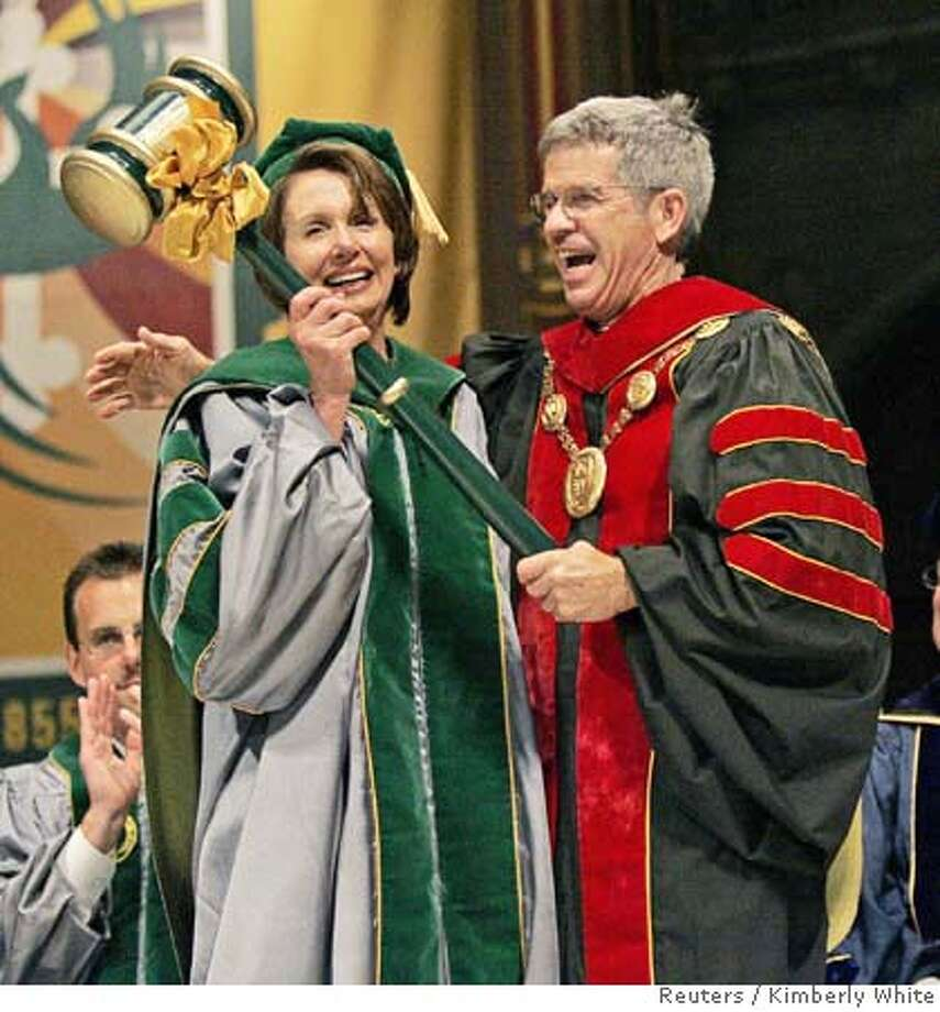 Speaker of the House Nancy Pelosi (D-CA) (L), is given an oversized gavel as a joke from Stephen Privett, president of the University of San Francisco in San Francisco, California, May 19, 2007. House Speaker Pelosi gave a brief speech to the graduating class of the McLaren College of Business. REUTERS/Kimberly White (UNITED STATES) Photo: KIMBERLY WHITE