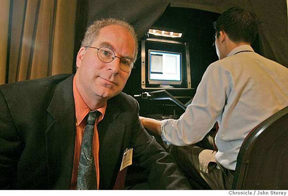 Kahle01_jrs_0129.jpg  Brewster Kahle who is a digital archivist next to his machine that digitizes books at the Golden Gate Club in the Presidio. John Storey San Francisco Event on 10/25/05 MANDATORY CREDIT FOR PHOTOG AND SF CHRONICLE/ -MAGS OUT Photo: John Storey