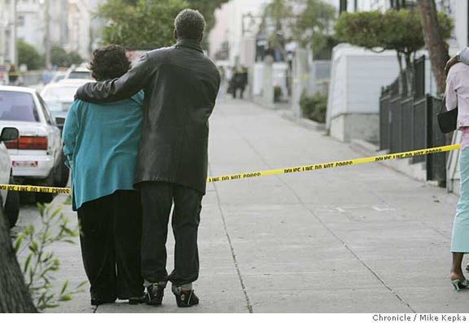 doublehomicide003seqn}_mk.JPG  Familiy members of one of the victims hang on to each other at the scene of the double homicide.  The night before Thanksgiving San Francisco had it 89th and 90th homicide of the year at Turk and Piece. San Francisco on date}. Mike Kepka / The Chronicle MANDATORY CREDIT FOR PHOTOG AND SF CHRONICLE/ -MAGS OUT Photo: Mike Kepka