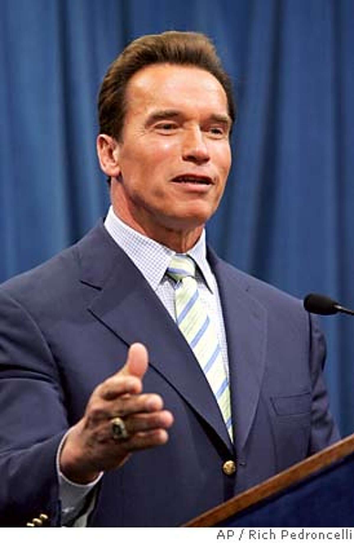 California Gov. Arnold Schwarzenegger answers a question during his first news conference since the defeat of his ballot intiatives in Tuesday's special election, at the Capiitol in Sacramento, Calif., Thursday, Nov. 10, 2005. Schwarzenegger took responsibility for the failure of his initiatives and said he learned that he needs more patience in seeking government reform. California voters rejected each of the initiatives Schwarzenegger was pushing on the special election ballot. (AP Photo/Rich Pedroncelli) Ran on: 11-13-2005 The governors trip is seen as an attempt to move forward politically after special election defeats. Ran on: 11-13-2005 The governors trip is seen as an attempt to move forward politically after special election defeats. Ran on: 11-13-2005 The governors trip is seen as an attempt to move forward politically after special election defeats.