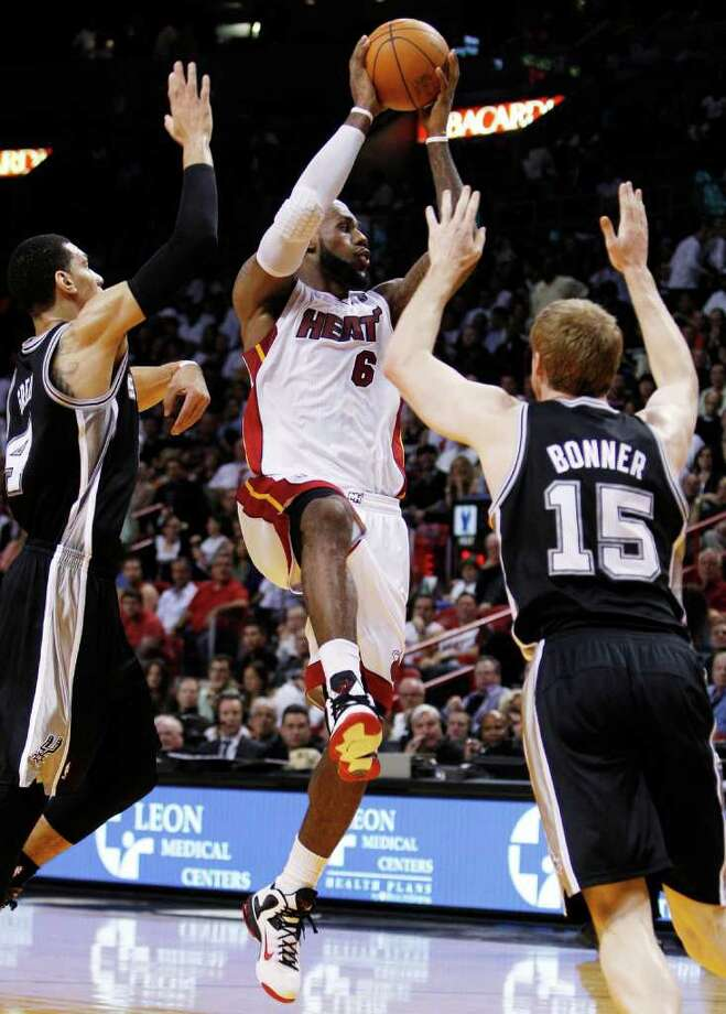 Miami Heat's LeBron James (6) looks to pass as San Antonio Spurs' Daniel Green (4) and Matt Bonner (15) defend during the first half of an NBA basketball game, Tuesday, Jan. 17, 2012, in Miami. (AP Photo/Lynne Sladky) Photo: Lynne Sladky