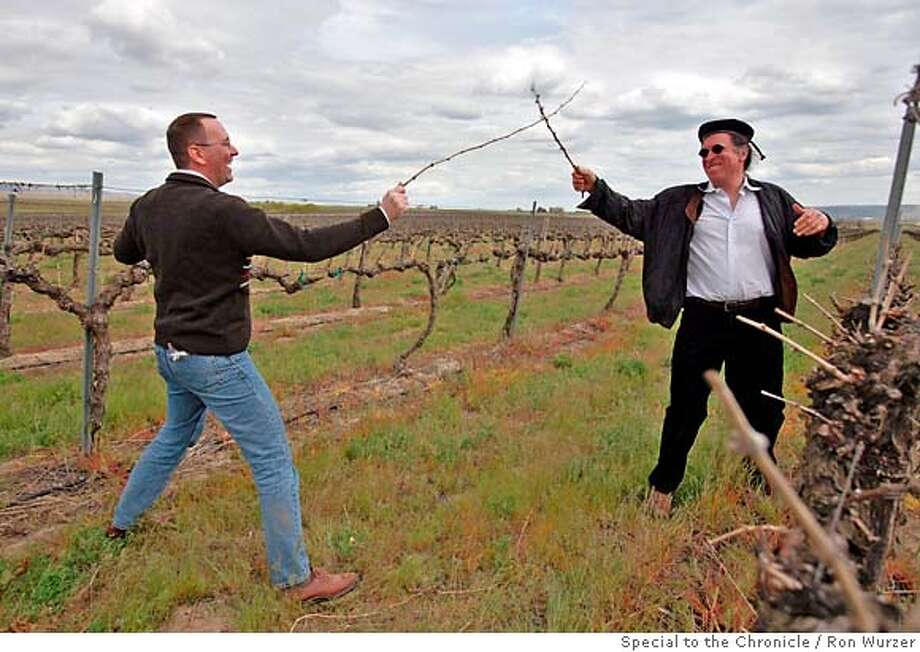 Randall Grahm (right), owner of Pacific Rim Winemakers, spars with general manager Nicolas Quill�, in Jim Willard's vineyard near Prosser, Wash. Photo by Ron Wurzer, special to the Chronicle