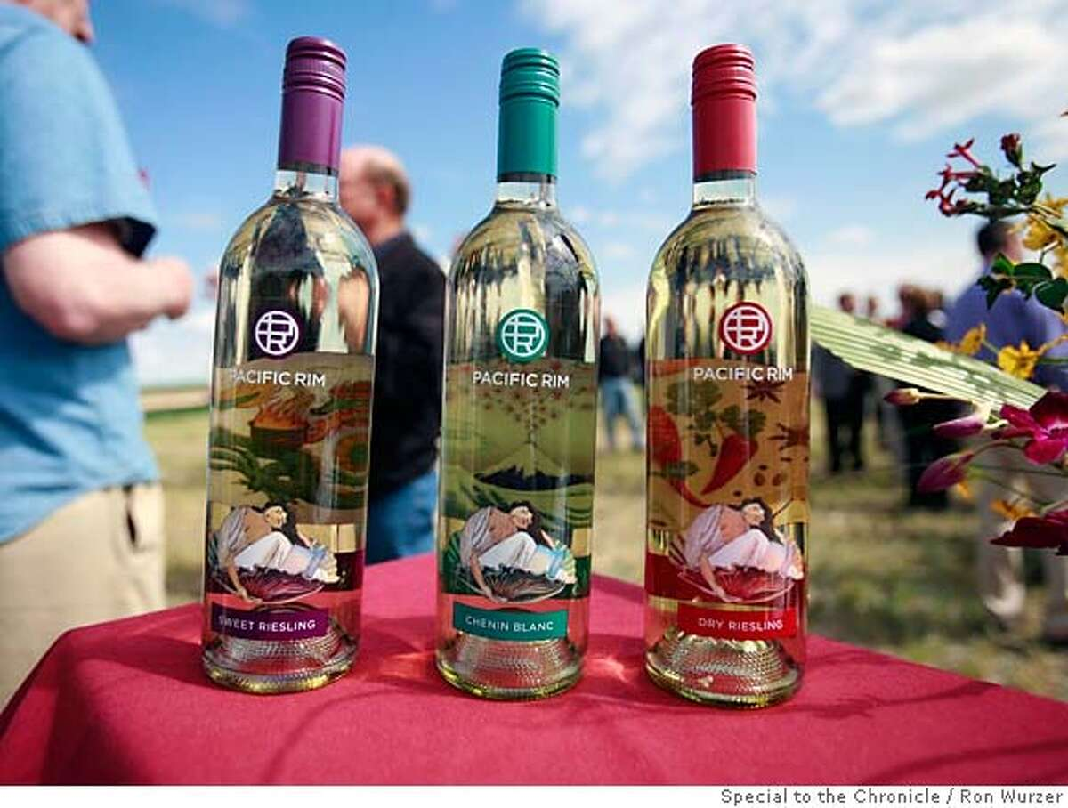 Three bottles await drinking at the Pacific Rim groundbreaking ceremony last month. From left, sweet Riesling, Chenin Blanc and dry Riesling. Photo by Ron Wurzer, special to the Chronicle