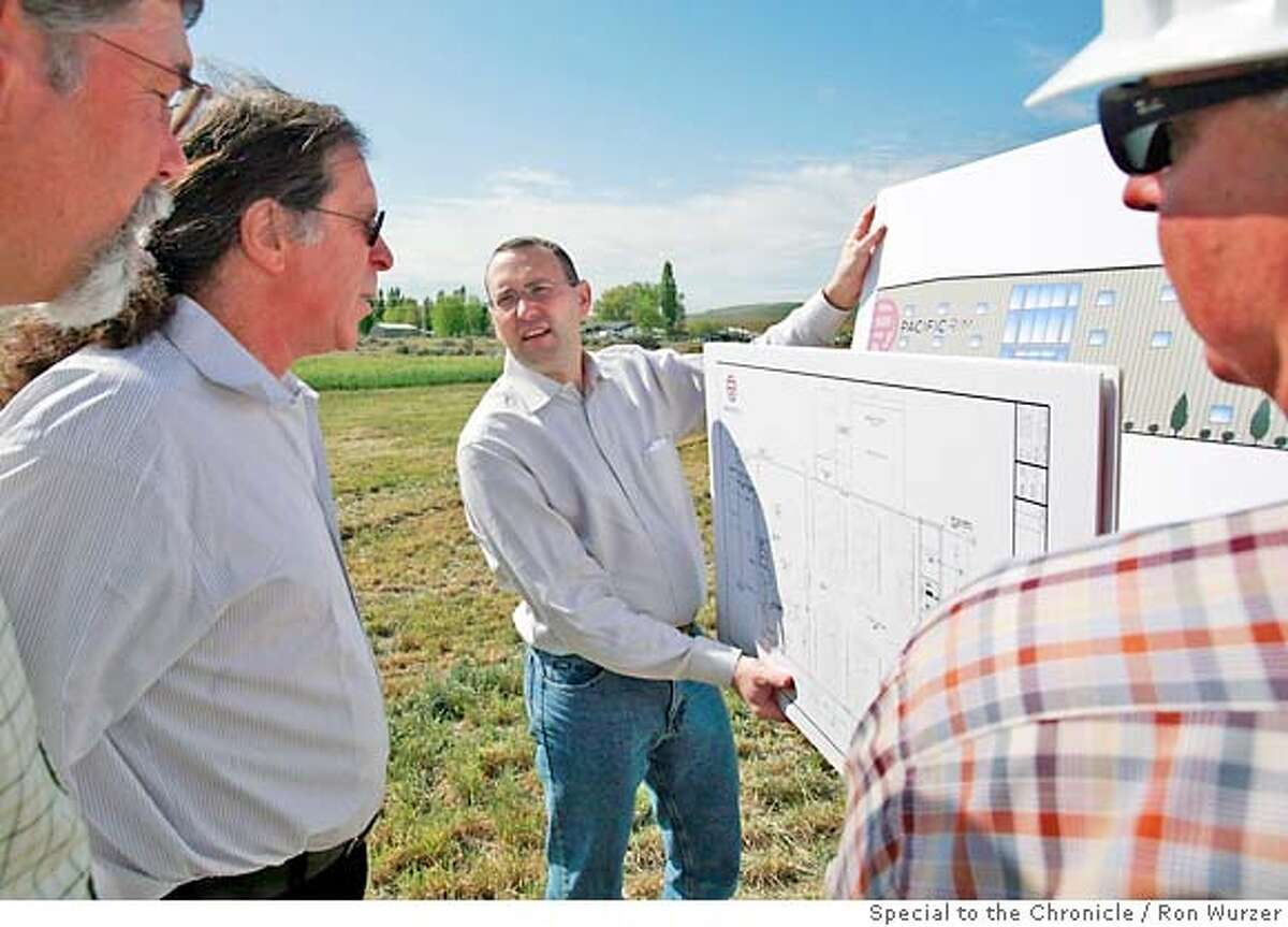 Nicolas Quill� (center), general manager of Pacific Rim Winemakers, goes over plans with owner Randall Grahm (second from left) at the groundbreaking ceremony for the winery.