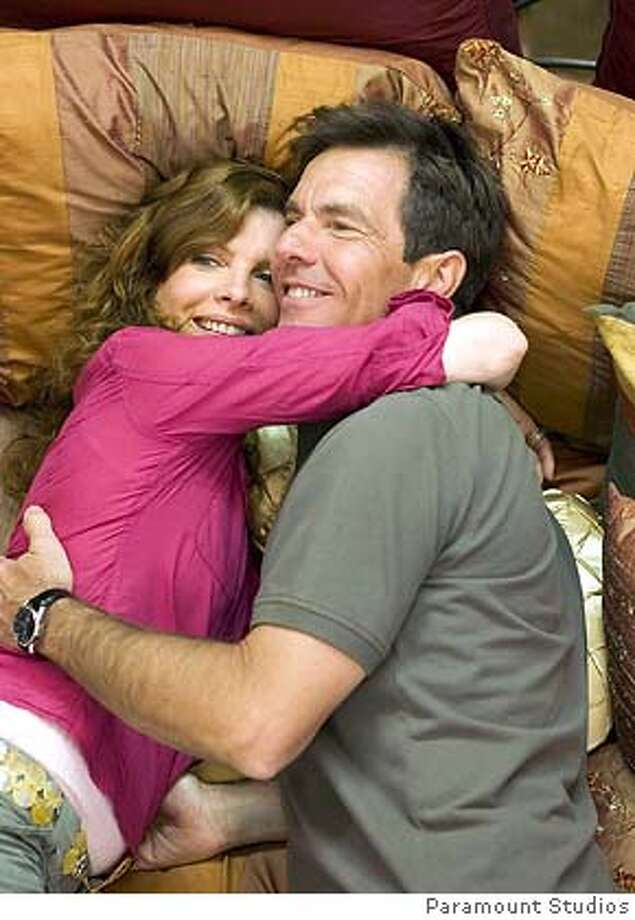 """An undated publicity photo shows actress Rene Russo (L) and actor Dennis Quaid in a scene from the new family comedy film """"Yours, Mine and Ours"""". The film opens in the United States November 23, 2005. NO ARCHIVES REUTERS/Paramount Studios/Handout 0 Photo: HO"""