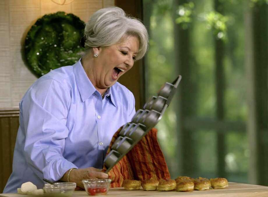 FILE- This undated file photo courtesy of Food Network shows celebrity chef Paula Deen. Deen recently announced that she has Type 2 diabetes. While Deen has cut out glass after glass of sweet tea and taken up treadmill walking off camera, she plans few changes on the air.  (AP Photo/Food Network, File) Photo: Anonymous