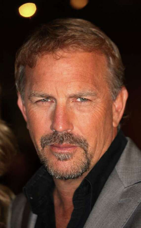 """(FILES) - Picture taken on December 16, 2009 shows US actor Kevin Costner attending the 20th anniversary screening of the film """"Field of Dreams"""" at the Academy of Motion Picture Arts and Sciences in Beverly Hills, California. Kevin Costner is to become a father for the seventh time, his third child with German wife Christine Baumgartner, the US actor told German magazine Bunte on March 17, 2010. Frederick M. Brown/Getty Images/AFP    -  FOR NEWSPAPERS, INTERNET, TELCOS & TELEVISION USE ONLY  - (Photo credit should read Frederick M. Brown/AFP/Getty Images) Photo: FREDERICK M. BROWN / GETTY IMAGES NORTH AMERICA"""