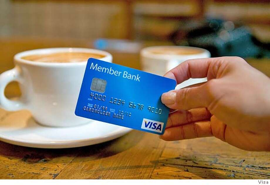 � In this undated handout photo released by Visa, the new Visa logo is shown on a credit card held by a model. Following the lead of MasterCard Inc., competitor Visa announced that it plans to restructure its organization to create a new company and then sell shares in an initial public offering. (AP Photo/Visa) Ran on: 10-12-2006 Visa follows the lead of rival MasterCard Inc. in announcing plans to go public. The IPO could raise $6 billion, making it one of the largest in U.S. history. HANDOUT IMAGE, NO SALES Photo: Visa