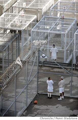 SANQUENTIN_180_pg.jpg  Below are 8x10 exercise cages for Grade B death row inmates who must enter and leave it in hand cuffs. Some, like this man in the black hat, can only exercise by himself.  A tour of San Quentin prison's death row, to show how bad of shape it is in and drum up support for a new death row there. There is, of course, plenty of opposition to keeping death row on such a prime piece of real estate.  . San Quentin on 10/26/04 by Penni Gladstone  San Francisco Chronicle Photo: Penni Gladstone