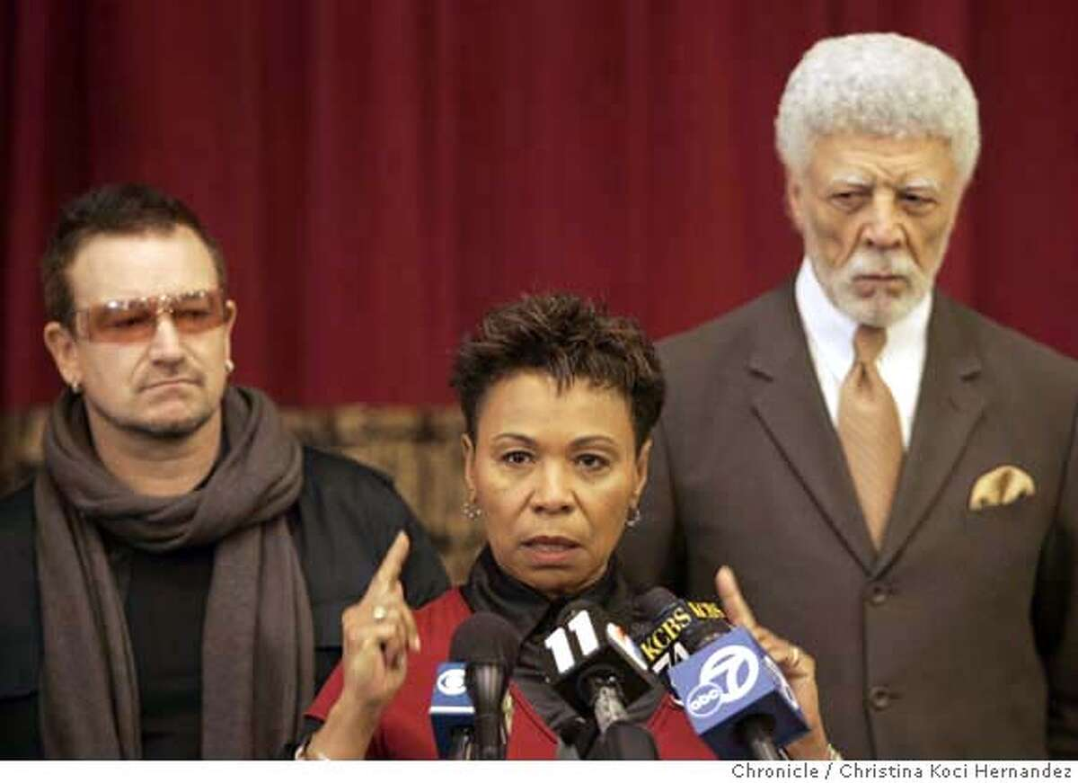 At Allen Temple Baptist Church, in Oakland, international AIDS activist and U2 lead singer (L), Bono, joins (middle) U.S. Rep. Barbara Lee and (R) Oakland Mayor Ron Dellums and faith leaders to discuss ways to fight HIV/AIDS in the urban African-American population. (Christina Koci Hernandez/The Chronicle) **Bono, Barbara Lee, Ron Dellums CHRONICLE Photos by CHRISTINA KOCI HERNANDEZ