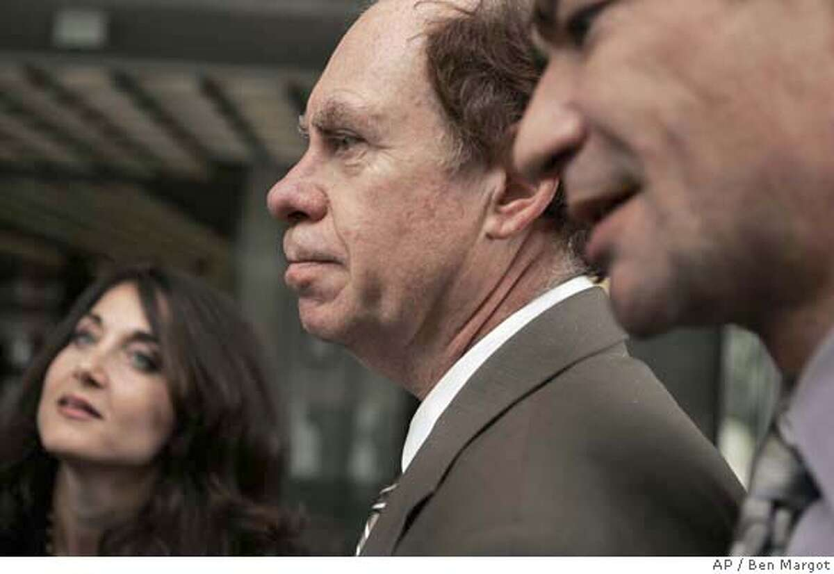 Ed Rosenthal, center, appears with his lawyers, Shari Lynn Greenberger, left, and Robert Amparan, outside a Federal courtroom Tuesday, May 15, 2007, in San Francisco. Ganja guru Ed Rosenthal returned to court Tuesday for opening arguments in a case federal prosecutors are retrying even though the pot advocate will face no prison time if convicted of growing marijuana. (AP Photo/Ben Margot)