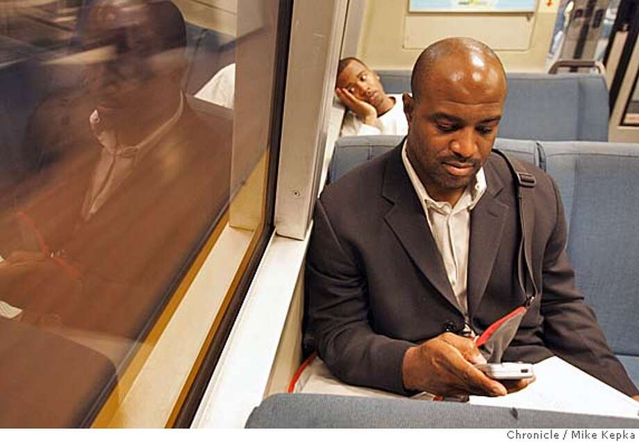 bartcell045seqn}_mk.JPG  While away from the office Dwayne Jones checks and sends emails from the Civic Center station on his personal Blackberry. (415 ) 726-5364  BART will be upgrading their underground lines with cell service. Riders with certain cell service have already been able to use their phones between City Center station and Embarcadero Station. San Francisco on date}. Mike Kepka / The Chronicle MANDATORY CREDIT FOR PHOTOG AND SF CHRONICLE/ -MAGS OUT Photo: Mike Kepka