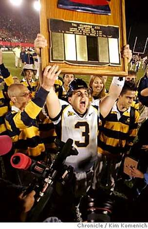 "Cal quaterback Steve Levy holds ""The Axe"" after leading the bears to a 27-3 victory over the Standord Cardinal at Stanford Saturday.  Stanford vs. Cal in the Big Game, held this year at Stanford.  San Francisco Chronicle Photo by Kim Komenich  11/19/05 Photo: Kim Komenich"