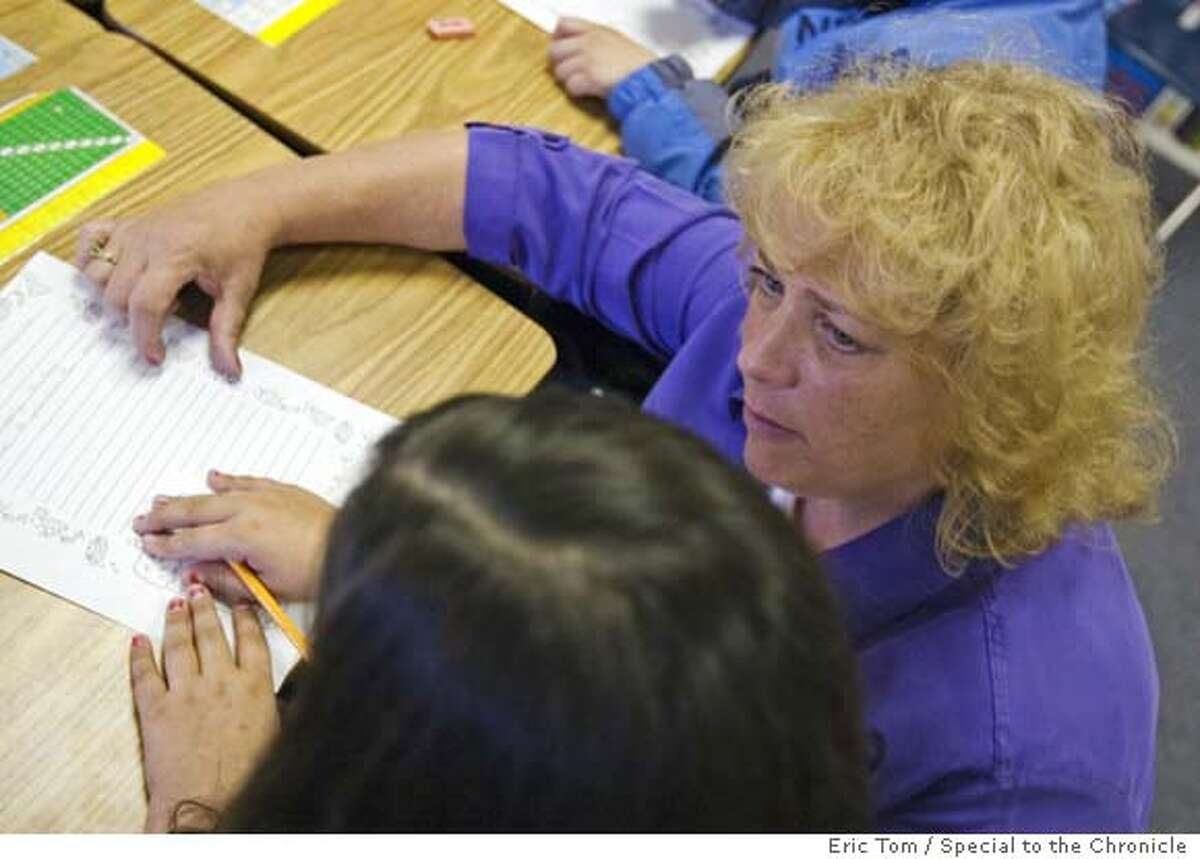 EDFUND06.jpg Julie Ahrens (cq) teaches to her third grade class at Del Rey Elementary in Victorville, CA on Friday, April 27, 2007. Ahrens owes Edfund $113,000, triple what she borrowed in the late 80s and early 90s. Ahrens refused to pay the increased amount, causing Edfund to garnish her wages. 'In that one month everything was beginning to spiral,' Ahrens said. **Julie Ahrens cq EDFUND BY ERIC TOM/DAILY PRESS/SPECIAL TO THE CHRONICLE
