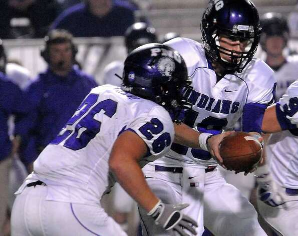 "PNG's Brennan Doty hands off to Chase Bertrand during the first half of the play off game at the Carrol A. ""Butch"" Thomas Educational Support Center in Beaumont, Saturday. Tammy McKinley/The Enterprise Photo: TAMMY MCKINLEY / Beaumont"