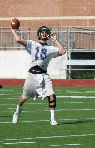 Quarterback Brennan Doty throws a pass during practice on Monday. The Indians' first game is Aug. 28.  David Henry/The Enterprise Photo: Dave Ryan / Beaumont