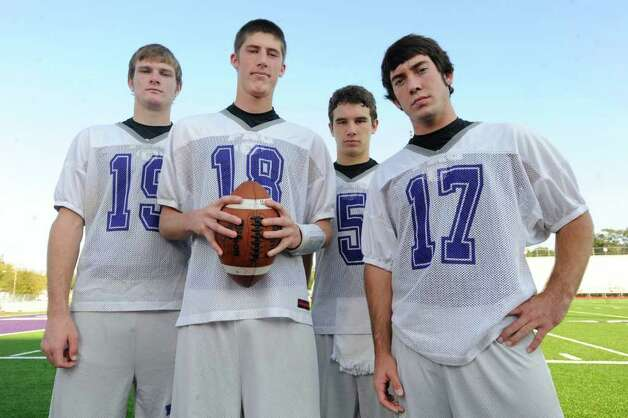 PN-G quarterback Brennan Doty, center, pictured with three PN-G receivers, from left, Spencer DeRon, Kyler Segura, and Blake Reyenga at The Reservation football field a day before playoff action against Mont Belvieu Barbers Hill at Stallworth Stadium in Bayton Friday night. Thursday, November 12, 2009. Valentino Mauricio/The Enterprise Photo: Valentino Mauricio / Beaumont