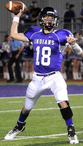 PN-G's Brennan Doty looks to pass against Nederland at Port Neches Groves High School in Port Neches, Friday.  Tammy McKinley, The Enterprise Photo: TAMMY MCKINLEY / Beaumont
