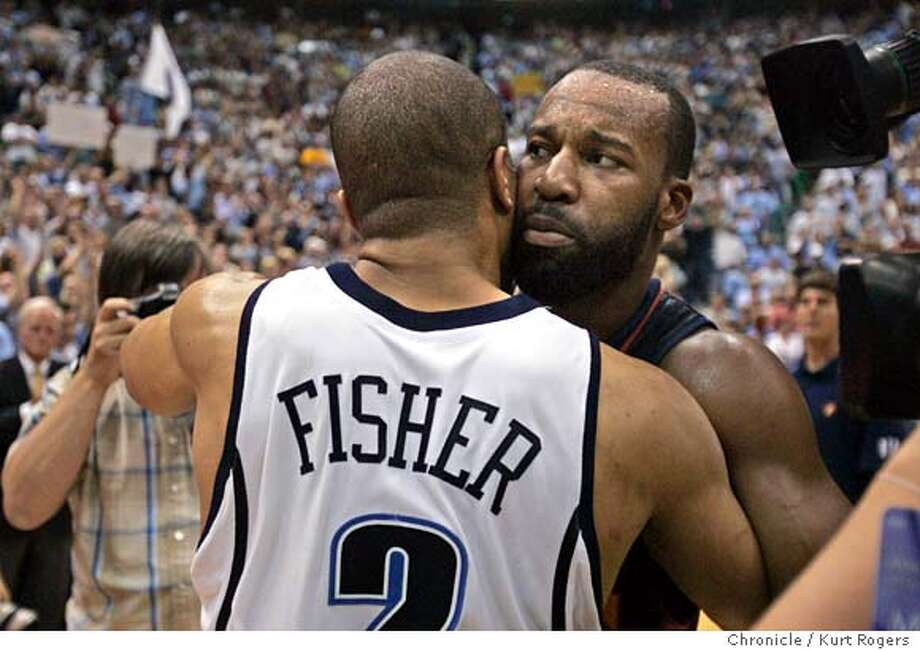 Baron Davis hugs Derek Fisher after the game  2007 NBA PLAYOFFFS-Western Conference Semifinals UTAH JAZZ vs GOLDEN STATE WARRIORS Series Game #5 EnergySolutions Arena .  SUNDAY, MAY 13, 2007 KURT ROGERS SALT LAKE CITY SFC  KURT ROGERS/THE CHRONICLE WARRIORS_4qt_game5_0772_kr.jpg  Ran on: 05-16-2007  Baron Davis, the Warriors' leader, hugs the irrepressible Derek Fisher after the hard-fought game that Utah's Fisher played a major role in winning. Photo: KURT ROGERS