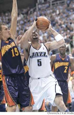 2e832b209 Golden State Warriors Andris Biedrins defends against Utah Jazz s Carlos  Boozer in the second quarter game