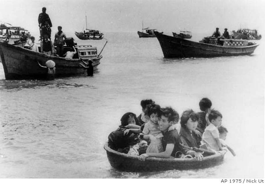 Vietnamese refugees escape from Vung Tau by boat and a makeshift craft to wait for U.S. ships. Associated Press photo, 1975, by Nick Ut