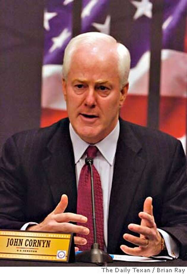 JOHN CORNYN ALBERTO GONZALES INTELLECTUAL PROPERTY FORUM Photo: BRIAN RAY