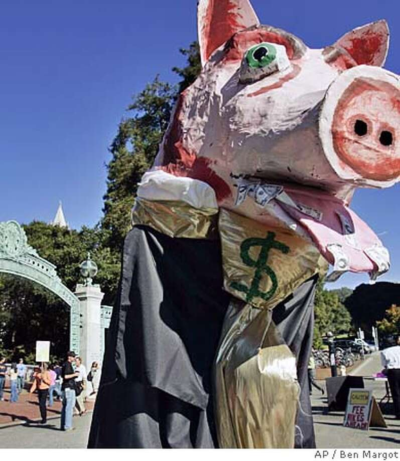 A protester dressed as a pig is seen at the University of California, Berkeley's Sather Gate on Wednesday, Nov. 16, 2005, in Berkeley, Calif. University of California regents voted Wednesday to raise fees for the fifth straight year, although they promised to roll back the hikes if the Legislature provides more money. UC Berkeley workers as well as students protested the hike. The fee hike, 8 percent for undergraduates, is part of a long-term funding agreement with Gov. Arnold Schwarzenegger. (AP Photo/Ben Margot) Photo: BEN MARGOT