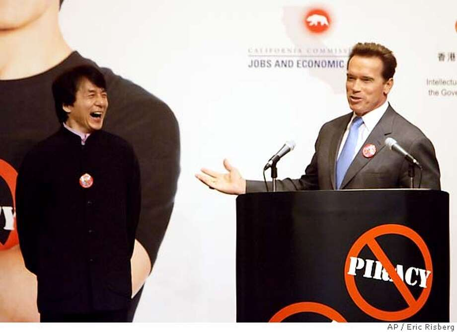 Actor Jackie Chan, left, laughs as California Gov. Arnold Schwarzenegger talks about their making of a public service announcement to promote the respect of intellectual property rights, during an American Chamber of Commerce luncheon in Hong Kong, Friday, Nov. 18, 2005. The public service announcement will be shown in Hong Kong. The governor is on a six-day trade mission to Beijing, Shanghai and Hong Kong. (AP Photo/Eric Risberg) Photo: ERIC RISBERG