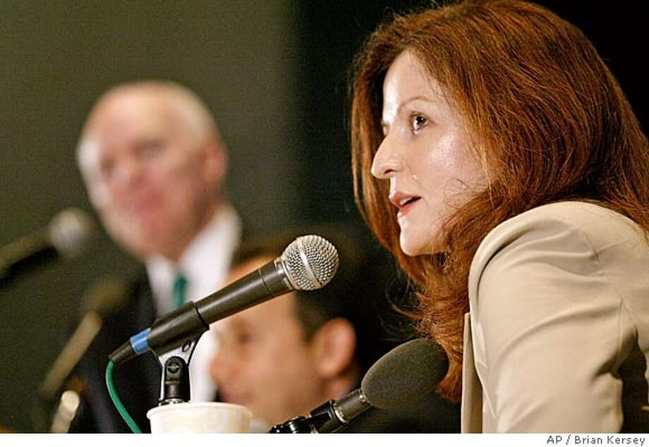 "Maureen Dowd, author of ""Bushworld: Enter at your own risk"", speaks during panel discussion during a luncheon at the Book Expo America convention, Saturday, June 5, 2004, in Chicago. (AP Photo/Brian Kersey) Photo: BRIAN KERSEY"
