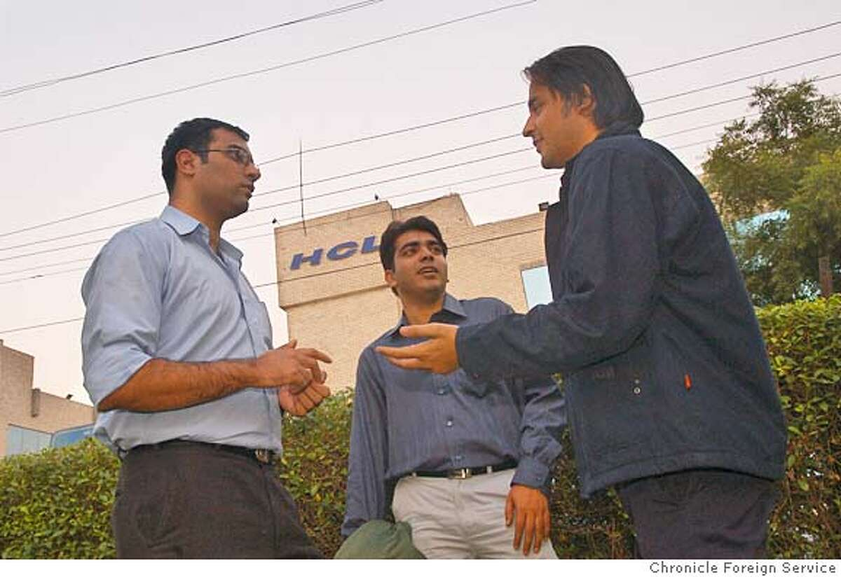From left, call centre workers Imran Malik, Sumit Bhasin and Saurabh Jha outside the office of HCL BPO technologies in Noida, India. Source: Chronicle Foreign Service